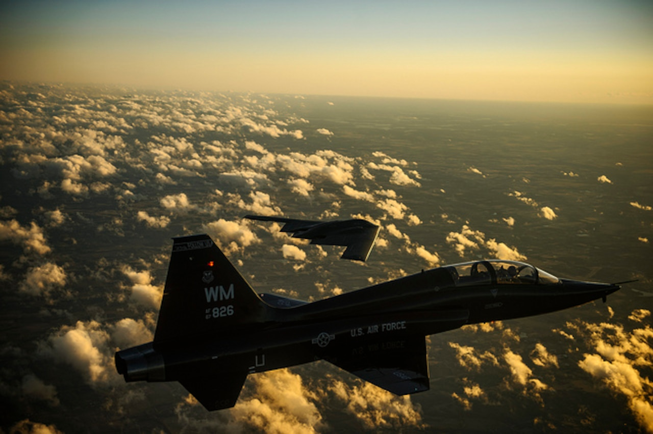 An Air Force T-38 Talon and B-2 Spirit fly in formation during a training mission over Whiteman Air Force Base, Mo., Feb. 20, 2014. The B-2 is a multirole bomber capable of delivering both conventional and nuclear ammunition. DoD photo by Air Force Staff Sgt. Jonathan Snyder