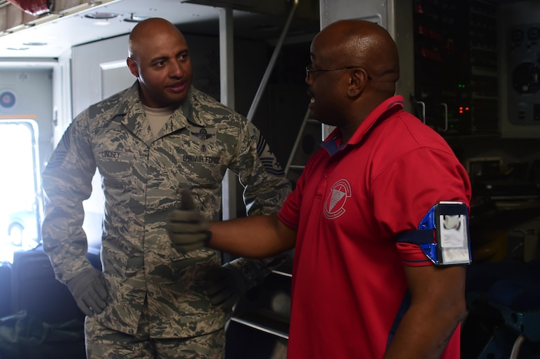 Andrew Mills, 460th Logistics Readiness Squadron airlift operations supervisor, explains his side of the mission to Chief Master Sgt. Rodney Lindsey, 460th Space Wing command chief July 12, 2016, on Buckley Air Force Base, Colo. The 460th LRS works together with the 140th LRS in order to safely load and unload cargo aircraft arriving and departing from Buckley AFB. (U.S. Air Force photo by Airman 1st Class Luke W. Nowakowski/Released)