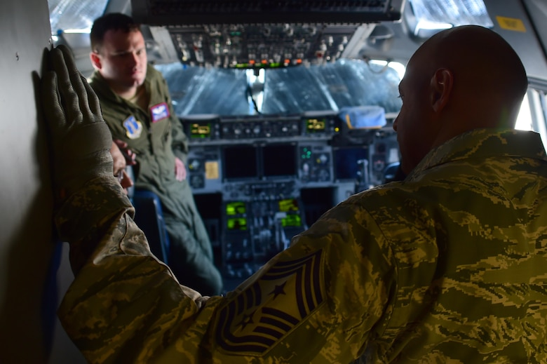 Chief Master Sgt. Rodney Lindsey, 460th Space Wing command chief, visits with the pilots of a C-17 Globemaster III from the Mississippi Air National Guard 183rd Airlift Wing July 12, 2016, on Buckley Air Force Base, Colo. The 183rd AW arrived to pick up and transport equipment and supplies needed by the 120th Fighter Squadron currently doing training operations in Papa, Hungary. (U.S. Air Force photo by Airman 1st Class Luke W. Nowakowski/Released)