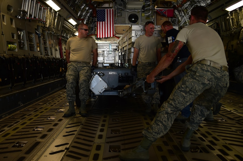 Airmen from the 140th Logistics Readiness Squadron load cargo onto a C-17 Globemaster III from the Mississippi Air National Guard 183rd Airlift Squadron July 12, 2016, on Buckley Air Force Base, Colo. The 183rd AS is transporting supplies and equipment to Papa, Hungary, that will be used to support the 120th Fighter Squadron, who is currently training with the Hungarian Air Force. (U.S. Air Force photo by Airman 1st Class Luke W. Nowakowski/Released)