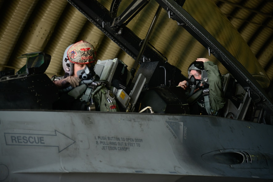 Capt. Scott Martin, 36th Fighter Squadron pilot, gives preflight instructions to Marc Knapper, U.S. Embassy to the Republic of Korea deputy chief of mission, before a familiarization flight in an F-16 Fighting Falcon at Osan Air Base, Republic of Korea, July 14, 2016. Knapper flew in the aircraft to better understand Seventh Air Force's role in the defense of the ROK as part of United States Forces Korea. (U.S. Air Force photo by Senior Airman Dillian Bamman/Released)