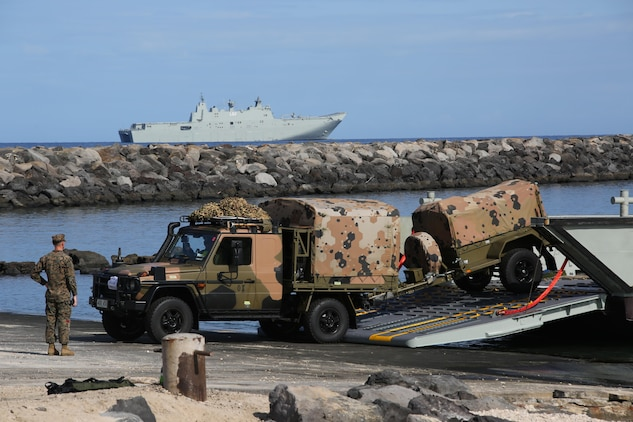 160712-M-UK649-034 KAWAIHAE PIER, Hawaii (July 12, 2016)  – Australian Soldiers with 2nd Battalion, Royal Australian Regiment debark Her Majesty's Australian Ship Canberra and come ashore at Kawaihae Pier, Hawaii, July 12, 2016, to participate in Rim of the Pacific 2016, a multinational military exercise. Twenty-six nations, 49 ships, six submarines, about 200 aircraft, and 25,000 personnel are participating in RIMPAC 16 from June 29 to Aug. 4 in and around the Hawaiian Islands and Southern California. The world's largest international maritime exercise, RIMPAC provides a unique training opportunity while fostering and sustaining cooperative relationships between participants critical to ensuring the safety of sea lanes and security on the world's oceans. RIMPAC 16 is the 25th exercise in the series that began in 1971. (U.S. Marine Corps Photo by Staff Sgt. Jesse R. Stence)