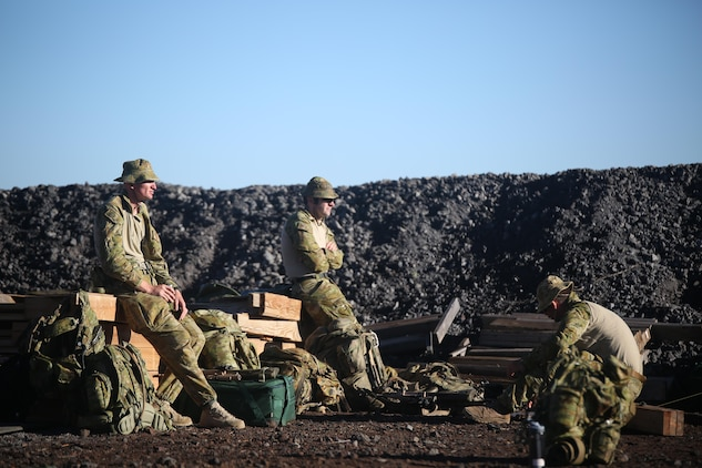 160713-M-UK649-029 POHAKUKLOA TRAINING AREA, Hawaii (July 13, 2016) – Australian Soldiers with 2nd Battalion, Royal Australian Regiment adjust to the arid, high-altitude conditions of Pohakuloa Training Area, Hawaii, before commencing a live fire range, July 13, 2016, during Rim of the Pacific 2016. Twenty-six nations, 49 ships, six submarines, about 200 aircraft, and 25,000 personnel are participating in RIMPAC 16 from June 29 to Aug. 4 in and around the Hawaiian Islands and Southern California. The world's largest international maritime exercise, RIMPAC provides a unique training opportunity while fostering and sustaining cooperative relationships between participants critical to ensuring the safety of sea lanes and security on the world's oceans. RIMPAC 16 is the 25th exercise in the series that began in 1971. (U.S. Marine Corps Photo by Staff Sgt. Jesse R. Stence)