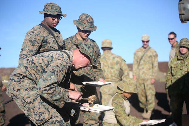 160713-M-UK649-046 POHAKULOA TRAINING AREA, Hawaii (July 13, 2016) – U.S. Marines enjoy field oatmeal along with an assortment of expeditionary cuisine in Pohakuloa Training Area, Hawaii, July 13, 2016, while encamped with 2nd Battalion, Royal Australian Regiment during Rim of the Pacific 2016. Twenty-six nations, 49 ships, six submarines, about 200 aircraft, and 25,000 personnel are participating in RIMPAC 16 from June 29 to Aug. 4 in and around the Hawaiian Islands and Southern California. The world's largest international maritime exercise, RIMPAC provides a unique training opportunity while fostering and sustaining cooperative relationships between participants critical to ensuring the safety of sea lanes and security on the world's oceans.  The Marines are with 2nd Battalion, 3rd Marine Regiment, which supports III Marine Expeditionary Force. (U.S. Marine Corps Photo by Staff Sgt. Jesse R. Stence)