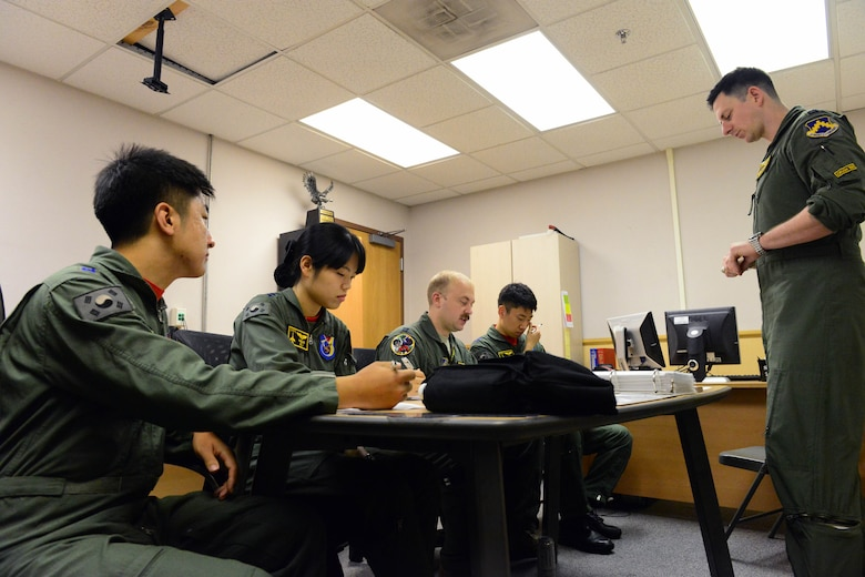 U.S. Air Force and ROKAF pilots participate in a pre-brief before soaring the skies in preparation for Buddy Wing 16-6 July 14, 2016 at Kunsan Air Base, Republic of Korea. Buddy Wing exercises are conducted at various ROKAF and U.S. Air Force bases multiple times throughout the year on the Korean peninsula. The combined fighter exchange program provides pilots an opportunity to exchange ideas and practice combined tactics in order to fight and fly as one Allied force. (U.S. Air Force photo by Senior Airman Ashley L. Gardner/ Released)