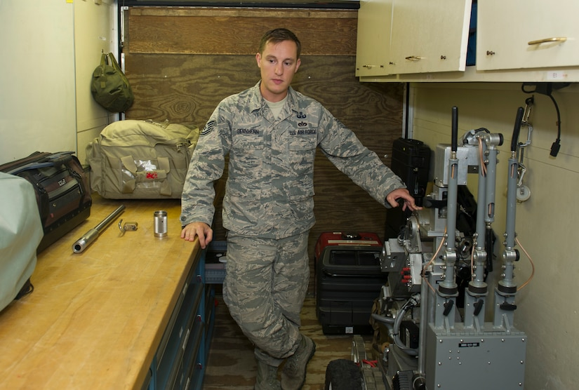 Tech. Sgt. Anthony Sennhenn, noncommissioned officer in charge of the 628th Civil Engineer Squadron Flight, Explosive Ordnance Disposal flight, explains various tools EOD uses to safely dispose of explosive devices. EOD Airmen serve as the Air Force's bomb squad and are trained to detect, disarm, detonate and dispose of explosive threats all over the world. (U.S. Air Force photo/Airman 1st Class Kevin West)