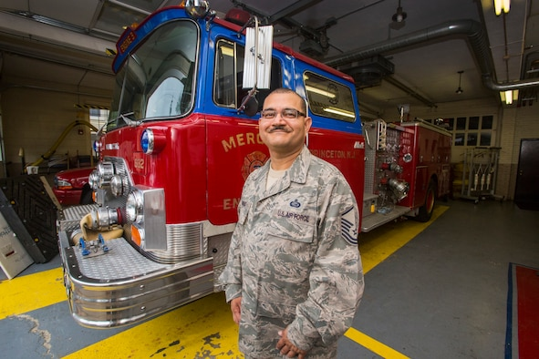 Master Sgt. Jorge A. Narvaez, left, 108th Wing Security Forces, New Jersey Air National Guard, poses for a photo in front of a 1982 Mack 1250 GPM pumper fire truck at Mercer Engine No. 3 fire department in Princeton, N.J., July 13, 2016. Narvaez was instrumental in getting the truck donated to a group of volunteer firefighters in Managua, Nicaragua through the Denton Program, which allows U.S. citizens and organizations to use space available on military cargo aircraft to transport humanitarian goods to countries in need. (U.S. Air National Guard photo by Master Sgt. Mark C. Olsen/Released)