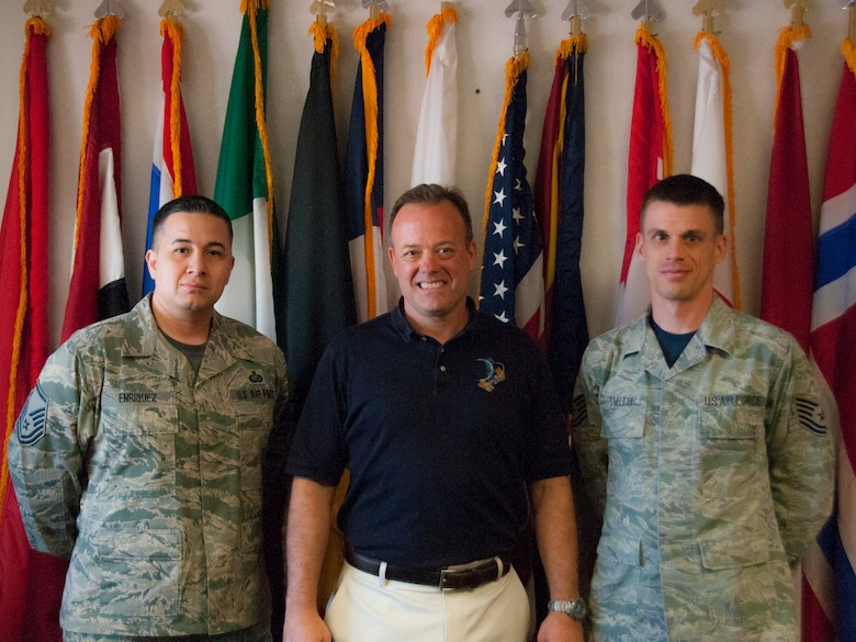 TUCSON, Ariz. – Ron Garan, the newest honorary commander at the 162nd Wing, poses for a photo with Master Sgt. Jesus Enriquez, left, and Tech. Sgt. Matthew Smith, right, in front of the partner nation flags on display at the International Military School Office here. Enriquez is the Non-Commissioned Officer in Charge of IMSO and Smith is the 162nd Operations Group unit training manager. Garan is the chief pilot at World View, a Tucson-based company that plans to operate commercial near-space flight for passengers as well as scientific research via balloon. Garan retired from active duty Air Force, and toured the base to get a feel for the Air National Guard and what a drill weekend is like.   (U.S. Air National Guard photo by Staff Sgt. Gregory Ferreira)