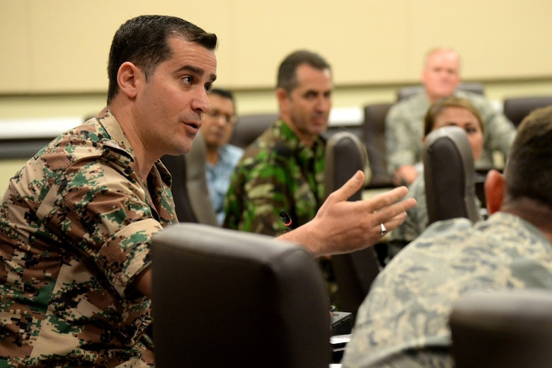 Jordanian Air Force Chief Master Sgt. Saif Aladammin speaks with U.S. Air 