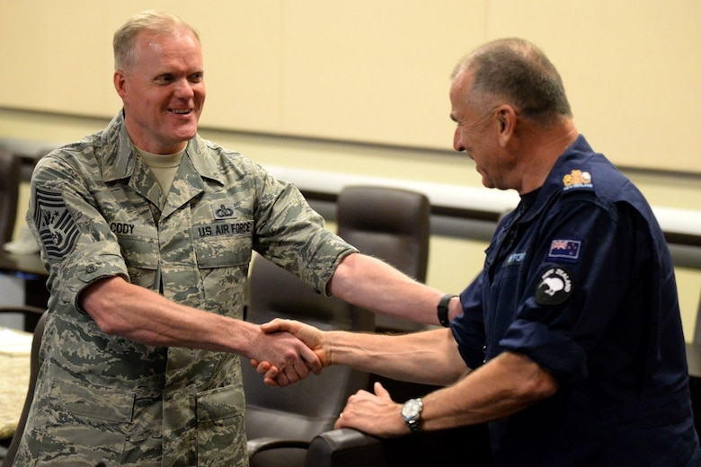 Chief Master Sergeant of the Air Force James A. Cody greets New Zealand Warrant Officer of Air Force Mark Harwood during the Senior Enlisted Leader International Summit (SELIS) on Joint Base Andrews, Md., July 13, 2016. The SELIS is a forum of international senior enlisted leaders hosted by the CMSAF. (U.S. Air Force photo/ Tech. Sgt. Matt Davis)