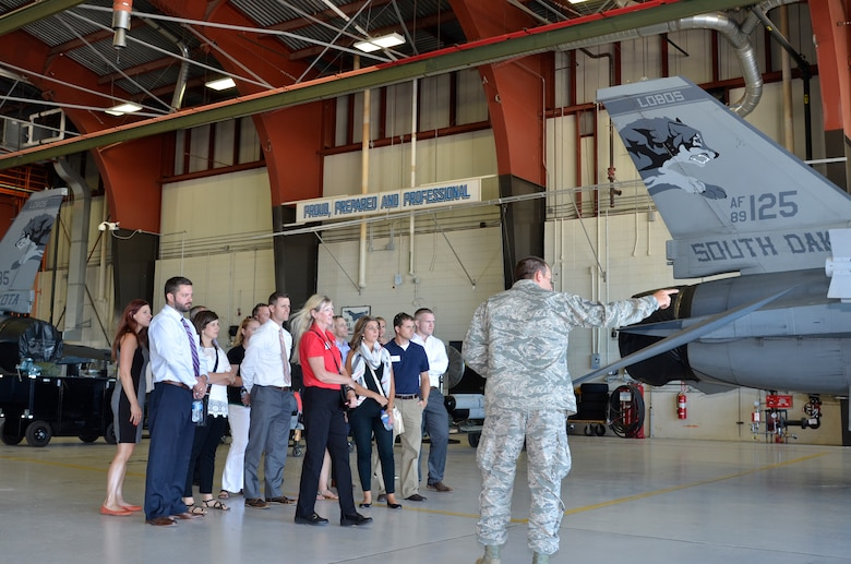 SIOUX FALLS, S.D. - Master Sgt. Chris Portice, 114th Maintenance Squadron avionics technician, explains to members of the Sioux Falls Area Chamber of Commerce Young Professionals Network what his position at the South Dakota Air National Guard includes during a tour given at Joe Foss Field, S.D. on July 13, 2016.(U.S. Air National Guard photo by Maj. Travis Schuring/released)
