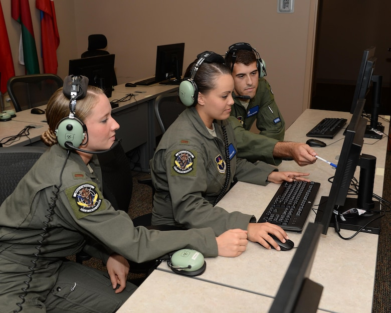 Students from the 337th Air Control Squadron monitor simulated battle space during an Undergraduate Air Battle Manager Course training exercise at Tyndall Air Force Base, Fla. July 13, 2016. Individuals who graduate this course are trained and qualified for airborne command and control, air surveillance, electronic warfare, and airborne weapons capabilities in aircraft. (U.S. Air Force photo by Airman 1st Class Cody R. Miller/Released)