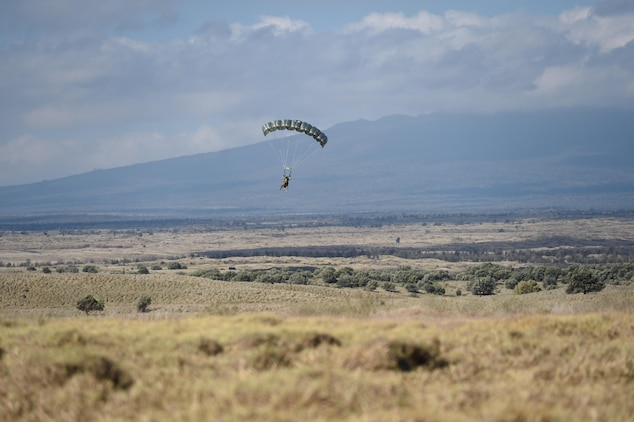 160709-F-DF491-215 POHAKULOA TRAINING AREA, Hawaii (July 9, 2016) – A Special Tactics Airman with the 320th Special Tactics Squadron performs a high-altitude, low-opening jump to infiltrate into a simulated disaster area during a humanitarian assistance and disaster response scenario as part of Rim of the Pacific 2016, at Pohakuloa Training Area, Hawaii, July 10, 2016. Twenty-six nations, more than 40 ships and submarines, more than 200 aircraft and 25,000 personnel are participating in RIMPAC from June 30 to Aug. 4, in and around the Hawaiian Islands and Southern California. The world's largest international maritime exercise, RIMPAC provides a unique training opportunity that helps participants foster and sustain the cooperative relationships that are critical to ensuring the safety of sea lanes and security on the world's oceans. RIMPAC 2016 is the 25th exercise in the series that began in 1971.(U.S. Air Force photo by 2nd Lt. Jaclyn Pienkowski)
