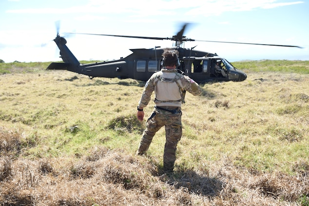 160710-F-DF491-288 POHAKULOA TRAINING AREA, Hawaii (July 9, 2016) -- A combat controller from the 320th Special Tactics Squadron clears a UH-60 Blackhawk for takeoff during a humanitarian assistance and disaster response as part of Rim of the Pacific 2016, at Pohakuloa Training Area, Hawaii, July 10, 2016. Twenty-six nations, more than 40 ships and submarines, more than 200 aircraft and 25,000 personnel are participating in RIMPAC from June 30 to Aug. 4, in and around the Hawaiian Islands and Southern California. The world's largest international maritime exercise, RIMPAC provides a unique training opportunity that helps participants foster and sustain the cooperative relationships that are critical to ensuring the safety of sea lanes and security on the world's oceans. RIMPAC 2016 is the 25th exercise in the series that began in 1971. (U.S. Air Force photo by 2nd Lt. Jaclyn Pienkowski)