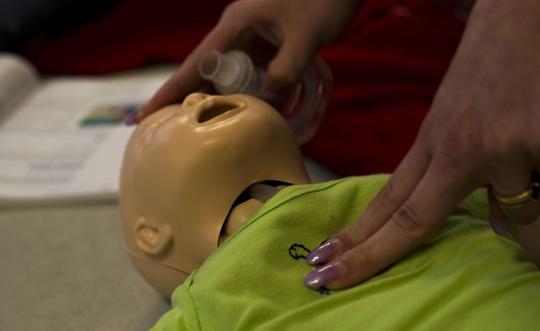 A student in the Ramstein Aquatic Center Lifeguard Course performs chest compressions on an infant dummy July 13, 2016, at Ramstein Air Base, Germany. The students were trained what to do if there's a drowning versus non-drowning victim, if it's an infant rather than an adult or the different roles depending on how many rescuers are responding. (U.S. Air Force photo/Airman 1st Class Tryphena Mayhugh)