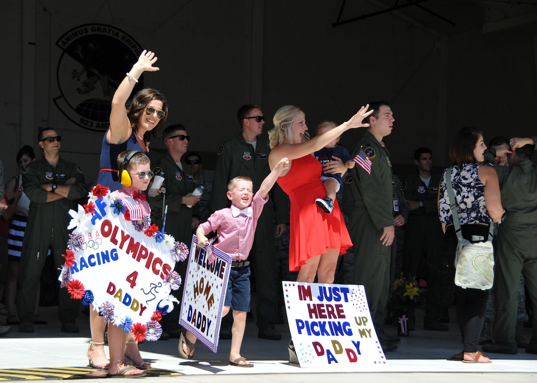 Twenty-three members of the 79th Rescue Squadron returned to Davis-Monthan Air Force Base, Ariz., July 13, 2016, following a four-month deployment to Southwest Asia. They returned on a C-130J Combat King II as their families, friends and squadron members eagerly awaited their arrival on the flightline. (U.S. Air Force photo/Carolyn Herrick)