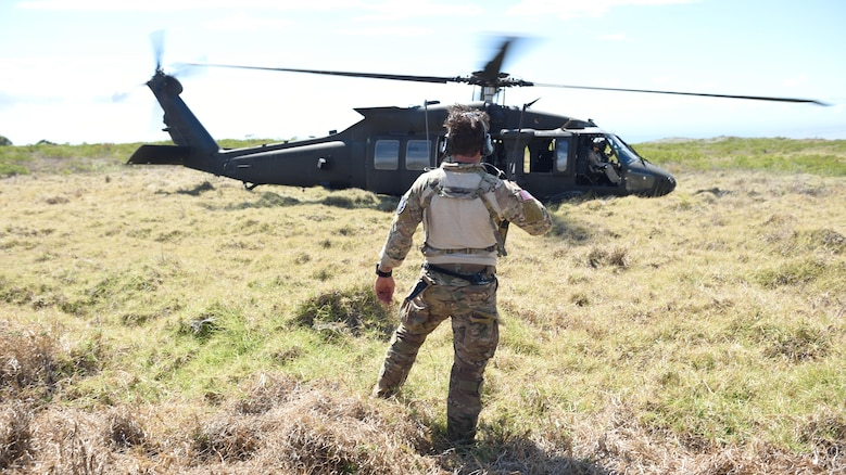 A combat controller from the 320th Special Tactics Squadron clears a UH-60 Blackhawk for takeoff during a humanitarian assistance and disaster response as part of Rim of the Pacific 2016, at Pohakuloa Training Area, Hawaii, July 10, 2016. Twenty-six nations, more than 40 ships and submarines, more than 200 aircraft and 25,000 personnel are participating in RIMPAC from June 30 to Aug. 4, in and around the Hawaiian Islands and Southern California. The world's largest international maritime exercise, RIMPAC provides a unique training opportunity that helps participants foster and sustain the cooperative relationships that are critical to ensuring the safety of sea lanes and security on the world's oceans. RIMPAC 2016 is the 25th exercise in the series that began in 1971.