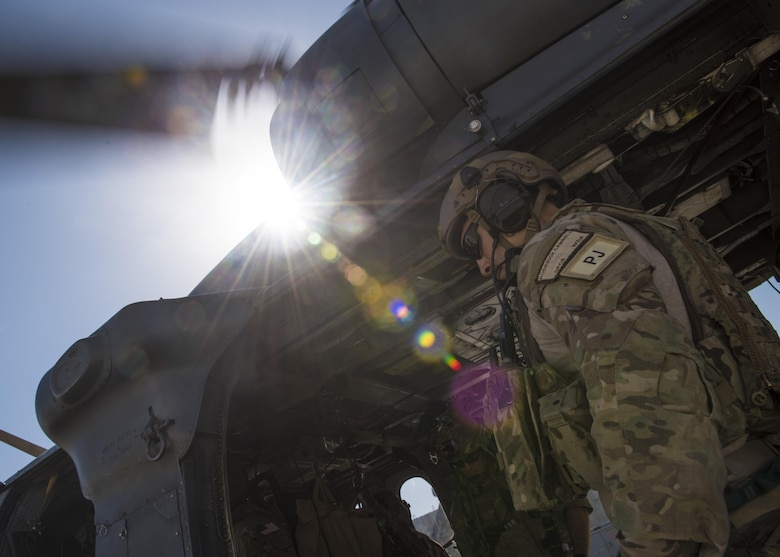 Staff Sgt. Roderick Campbell, an 83rd Expeditionary Rescue Squadron pararescueman, boards an HH-60G Pave Hawk while participating in a personnel recovery exercise in Bagram Airfield, Afghanistan, June 09, 2016. The 83rd ERQS provides the only isolated personnel recovery capability to U.S. forces in Afghanistan. (U.S. Air Force photo/Senior Airman Justyn M. Freeman)