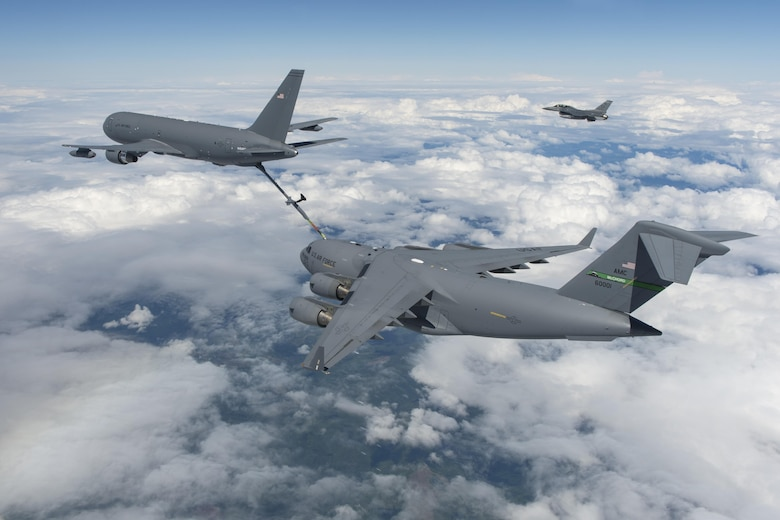 A KC-46A Pegasus refuels a C-17 Globemaster III during a test flight July 12, 2016. The successful mission tested the hydraulic pressure relief valves installed on the KC-46A to correct higher than expected axial loads in the boom. (Boeing photo/Paul Weatherman)