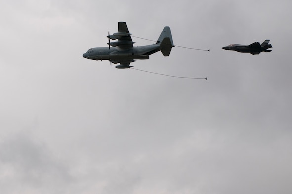 An F-35B Lightning II and a C-130J Super Hercules participate in an aerial demonstration at the Farnborough International Air Show, July 12, 2016. Held every two years, the air show represents a unique opportunity for the U.S., along with other military allies, to showcase its leadership in aerospace technologies while supporting various armament procurement competitions taking place throughout Europe. (U.S. Air Force photo by Master Sgt. Eric Burks/Released)