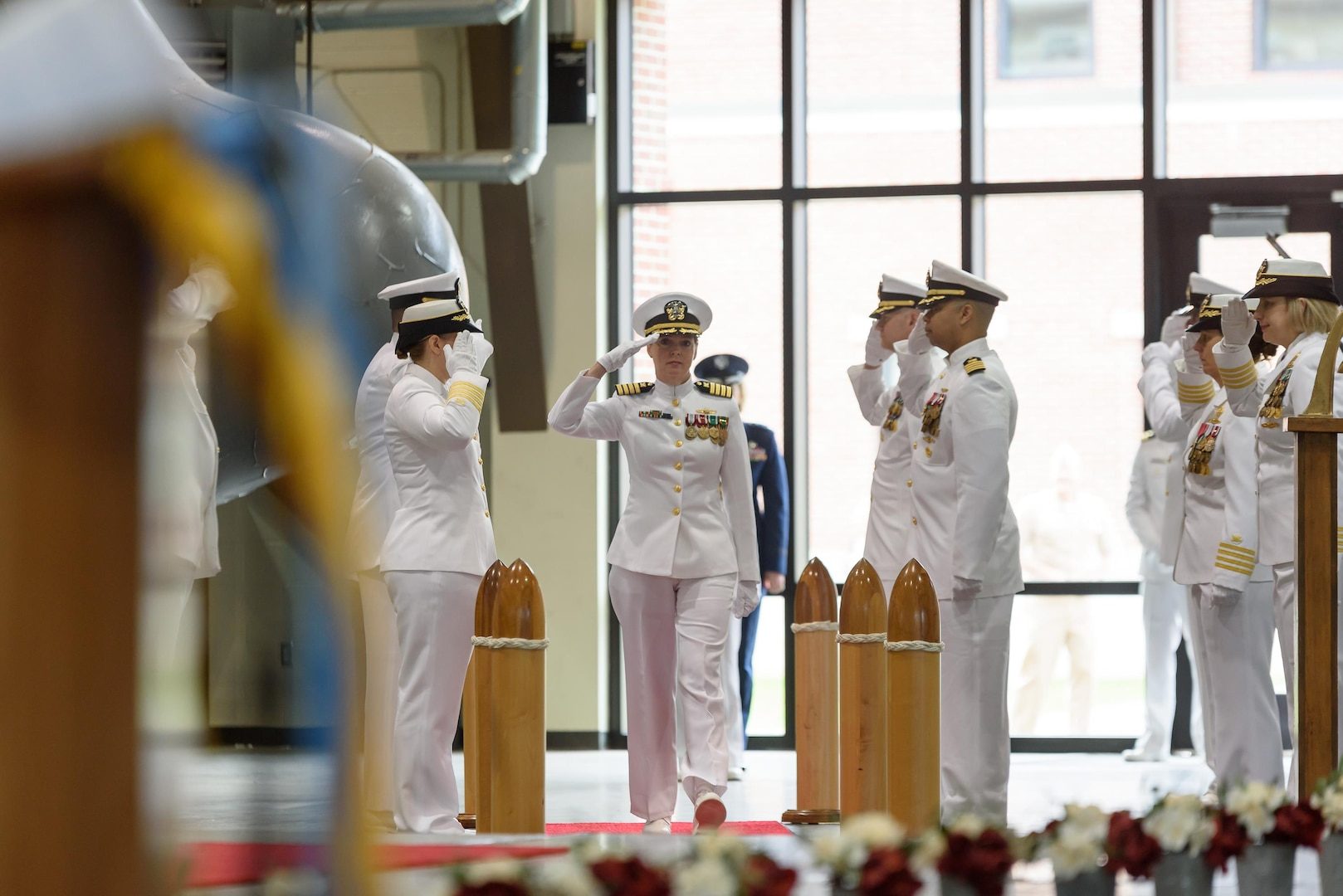Navy Capt. Sonya Ebright passes through the sideboys at the start of Defense Contract Management Agency International's change of command ceremony at Fort Lee, Virginia, May 23. Ebright assumed command from Navy Rear Adm. Deborah Haven who had presided over the agency's international contract administration operations in 26 different countries overseeing 9,600 contracts totaling over $75 billion in program value.
