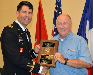 Robert P. Morris Jr., Program Manager, Small Business and Deputy Chief, Program and Project Management Division receives Small Business Program Manager of the Year for 2015 award during Forth Worth District Engineer Day Annual Awards Ceremony, June 14 from Lt. Col. Clay Morgan deputy commander, Fort Worth District.