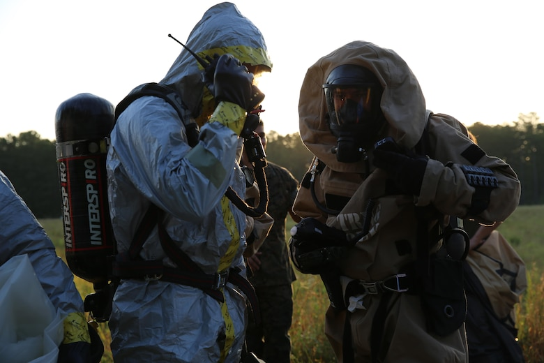Marines with Marine Corps Air Station Cherry Point's Explosive Ordnance Disposal and 2nd Marine Aircraft Wing's Chemical, Biological, Radiological and Nuclear Defense conduct radio checks during a training exercise at MCAS Cherry Point, N.C., July 12, 2016. The training further refined the interoperability between EOD and CBRN. (U.S. Marine Corps photo by Lance Cpl. Mackenzie Gibson/Released)