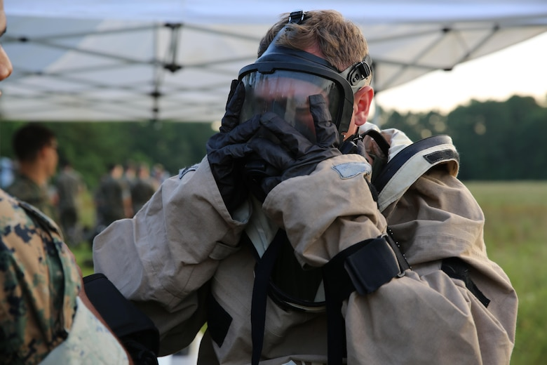 Lance Cpl. Ryan Shriver dons his gas mask during a training exercise at Marine Corps Air Station Cherry Point, N.C., July 12, 2016. The purpose of the training was to further refine the interoperability between MCAS Cherry Point's Explosive Ordnance Disposal and 2nd Marine Aircraft Wing's Chemical, Biological, Radiological and Nuclear Defense. Shriver is a CBRN defense specialist with Marine Wing Headquarters Squadron 2. (U.S. Marine Corps photo by Lance Cpl. Mackenzie Gibson/Released)
