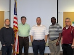 Defense Contract Management Agency quality assurance specialists Scott Kirisits, Edward Pawelczyk, Eric Lee, Komlan Koudifo and Jason Drewitz, recently passed the certified quality auditor course, which has enhanced their skills when participating in an audit. All of them are based at DCMA Air Propulsion Operations Rolls Royce in Indianapolis, Indiana.
