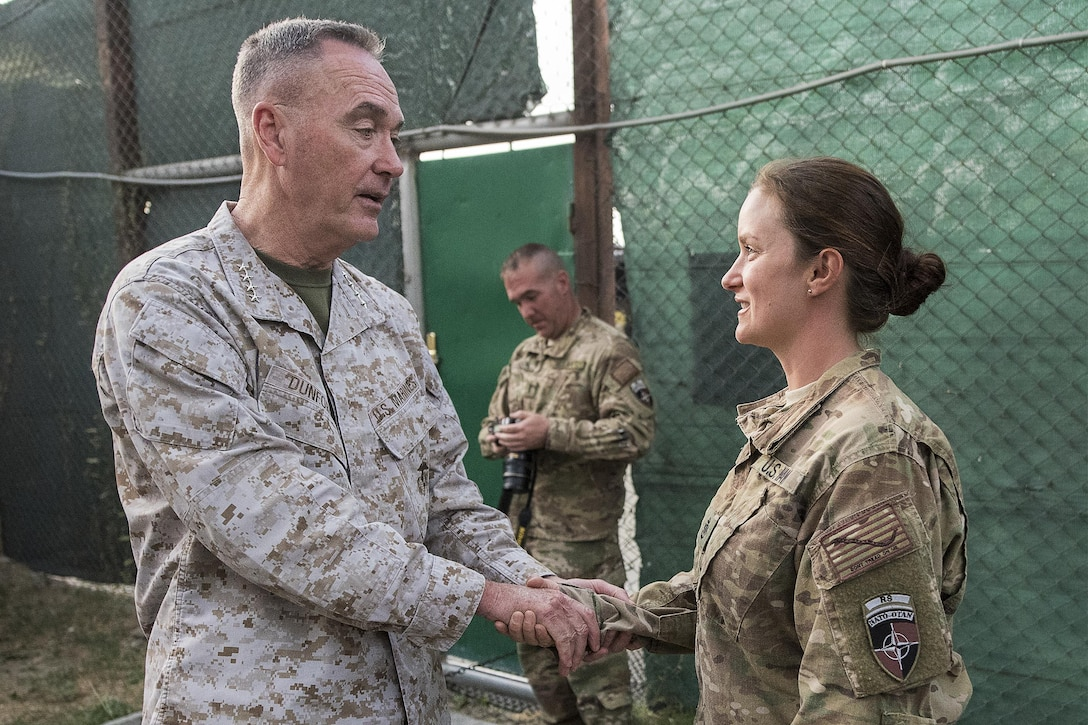 Marine Corps Gen. Joe Dunford, chairman of the Joint Chiefs of Staff, greets Navy Chief Petty Officer Mel Rowe in Kabul, Afghanistan, July 15, 2016. DoD photo by Navy Petty Officer 2nd Class Dominique A. Pineiro