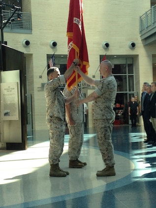 Colonel William (Beau) McClane assumes command of Marine Corps Information Operations Center (MCIOC) from Colonel Drew Cukor in the exchange of the banner during the ceremony officiating the transfer of command.