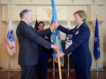 Air Force Lt. Gen. Wendy Masiello, incoming Defense Contract Management Agency director, accepts the agency's flag from Under Secretary of Defense for Acquisition, Technology and Logistics Frank Kendall during a change of leadership ceremony on Fort Lee, Va., today.