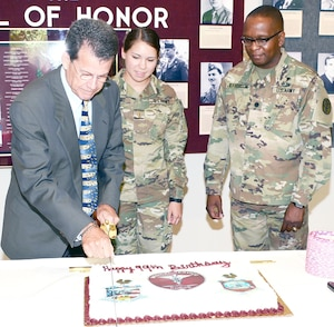 (From left) Retired Col. Greg Griffin, 2nd Lt. Hannah Martinez, and Lt. Col. Marion Jefferson cut the ceremonial cake at June 30 at the U.S. Army Medical Department Museum at Fort Sam Houston., celebrating 99 years of the Medial Service Corps.