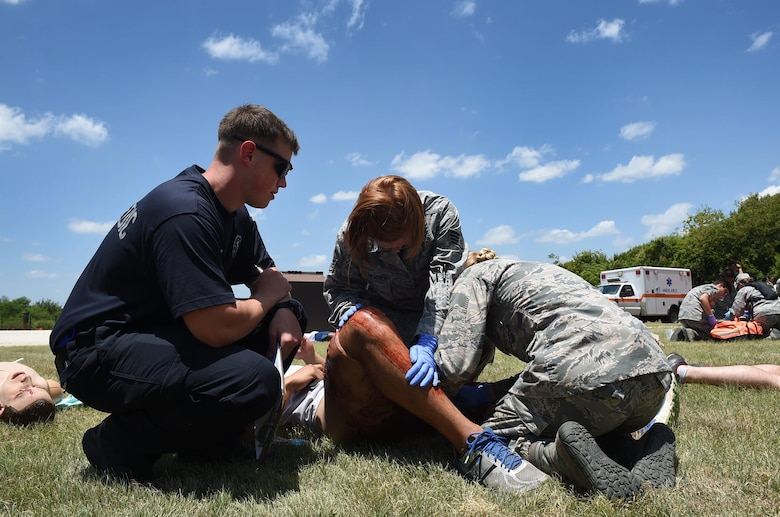 Senior Airman Lucas Reaume, a paramedic from the 59th Emergency Medical Services team, observes medics from the 59th MDW as they triage a patient during a July 13, 2016 disaster response exercise at Camp Bramble on Joint Base San Antonio-Lackland, Texas. The paramedics served as evaluators during the exercise, which simulated an aircraft crash. Evaluators were tasked to assess the response, and identify best practices and areas for improvement to ensure that 59th MDW warrior medics remain mission ready and capable. (U.S. Air Force photo/Staff Sgt. Jerilyn Quintanilla)