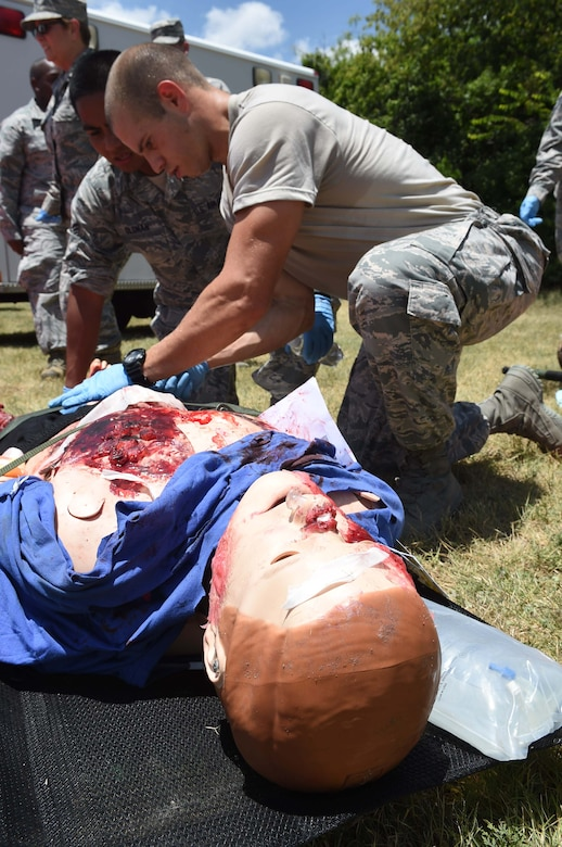 Medics from the 59th Medical Wing triage a patient during a disaster response exercise July 13, 2016 at Camp Bramble on Joint Base San Antonio-Lackland, Texas. The exercise simulated an aircraft crash designed to test the medics' response skills in the event of a similar real-world incident. (U.S. Air Force photo/Staff Sgt. Jerilyn Quintanilla)