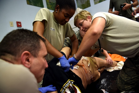 Warrior medics from 59th Medical Wing treat a patient suffering from simulated injuries during a July 13, 2016 disaster response training exercise at Camp Bramble on Joint Base San Antonio-Lackland, Texas. The exercise, which simulated an aircraft crash, was designed to test the medics' response skills in the event of a similar real-world incident. (U.S. Air Force photo/Staff Sgt. Jerilyn Quintanilla)