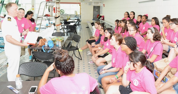 Cmdr. Jeffrey Reynolds, executive officer, Navy Recruiting District San Antonio, speaks with middle school girls after the completion of a SeaPerch Competition held at the Ann Barshop Natatorium on the campus of the University of the Incarnate Word as a part of the miniGEMS (Girls in Engineering, Math and Sciences) program.  SeaPerch is an innovative underwater robotics program that equips teachers and students with the resources they need to build an underwater ROV in an in-school or out-of-school setting. (U.S. Navy Photo by Burrell Parmer, Navy Recruiting District San Antonio Public Affairs/Released)