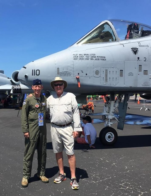 Col. Scott Caine, 9th Air Force vice commander, and his friend George Simon stand next to an A-10 Thunderbolt II at the Vero Beach Air Show, June 25, 2016. Caine, who calls Vero Beach home, had the opportunity to tell community members about the Air Force and thank them for their support. (Courtesy photo)