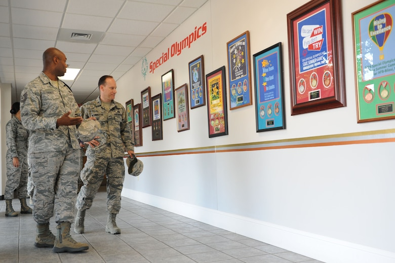 Tech. Sgt. James Thomas, 81st Training Group military training leader, briefs Col. Todd Weyerstrass, 2nd Air Force vice commander, on Keesler's involvement with Special Olympics Mississippi Summer Games during an 81st Training Wing orientation tour at the Levitow Training Support Facility July 12, 2016, on Keesler Air Force Base, Miss. The purpose of the tour was to become familiar with the wing's mission, operations and personnel. (U.S. Air Force photo by Kemberly Groue/Released)