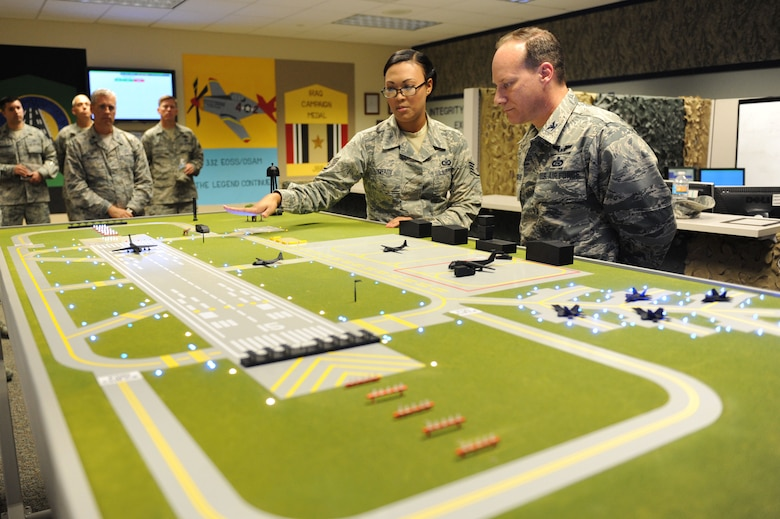 Staff Sgt. Shamena Grady, 334th Training Squadron instructor, briefs Col. Todd Weyerstrass, 2nd Air Force vice commander, on the air traffic control course at Cody Hall during an 81st Training Wing orientation tour July 12, 2016, on Keesler Air Force Base, Miss. The purpose of the tour was to become familiar with the wing's mission, operations and personnel. (U.S. Air Force photo by Kemberly Groue/Released)
