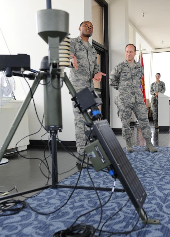 Tech. Sgt. Jonathan Winston, 335th Training Squadron instructor, briefs Col. Todd Weyerstrass, 2nd Air Force vice commander, on the weather training course at the Weather Training Facility during an 81st Training Wing orientation tour July 12, 2016, on Keesler Air Force Base, Miss. The purpose of the tour was to become familiar with the wing's mission, operations and personnel. (U.S. Air Force photo by Kemberly Groue/Released)