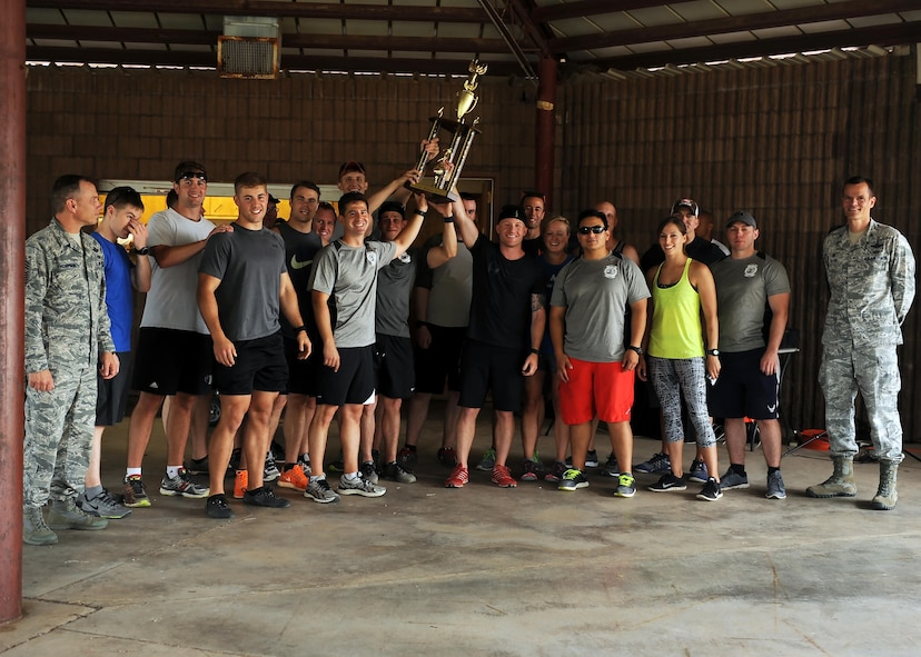 "Air Commandos with the 16th Special Operations Squadron celebrate their first-place finish in Cannon Culture Day's ""amazing race"" July 8, 2016 at Cannon Air Force Base, N.M. The race included stations testing Air Commandos' strength, knowledge, and multicultural awareness."