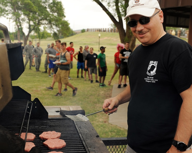 U.S. Air Force Chief Master Sgt. Robert Liddy, 27th Special Operations Aircraft Maintenance Squadron chief enlisted manager, serves burgers at the 27th Special Operations Wing's first Culture Day July 8, 2016, at Cannon Air Force Base, N.M. The event was created to highlight the wide range of cultures and ethnic backgrounds represented by Cannon's Air Commandos.