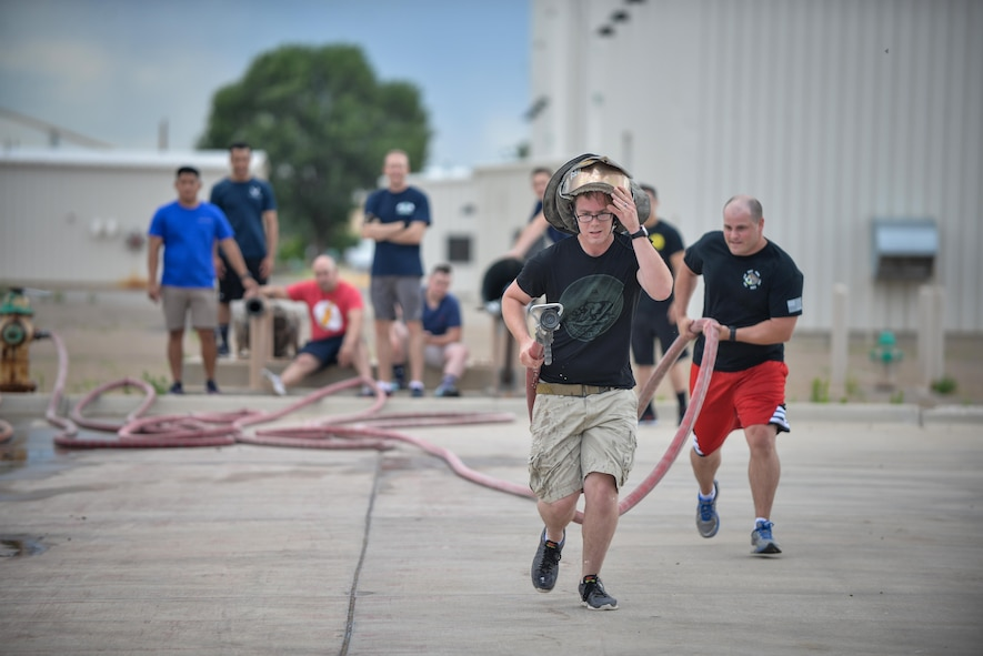 "Air Commandos compete in a fire rescue station at Cannon Culture Day's ""amazing race"" July 8, 2016 at Cannon Air Force Base, N.M. The race included stations testing Air Commandos' strength, knowledge, and multicultural awareness."