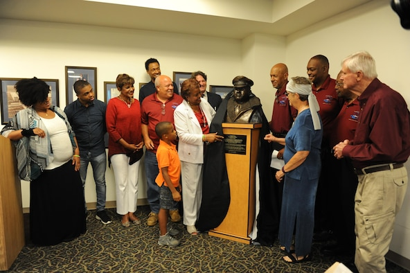 Family members and friends of Col. Lawrence E. Roberts, Tuskegee Airman, unveil a sculptured bust in his honor at the Gulfport-Biloxi International Airport July 13, 2016, Gulfport, Miss. Keesler personnel, family members, friends and community representatives gathered for the ceremony to honor Roberts, who began and ended his 32-year military career at Keesler. (U.S. Air Force photo by Kemberly Groue/Released)