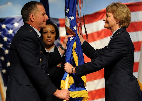 U.S. Air Force Chief of Staff, Gen. David L. Goldfein, passes the Air Force Reserve Command guidon to Lt Gen. Maryanne Miller during the AFRC change of command ceremony at the Museum of Aviation, Warner Robins, Georgia, July 15, 2016. Miller became the Air Force Reserve's first female lieutenant general and the first female Chief of the Air Force Reserve and commander of Air Force Reserve Command. (U.S. Air Force photo by Tech Sgt. Stephen D. Schester)