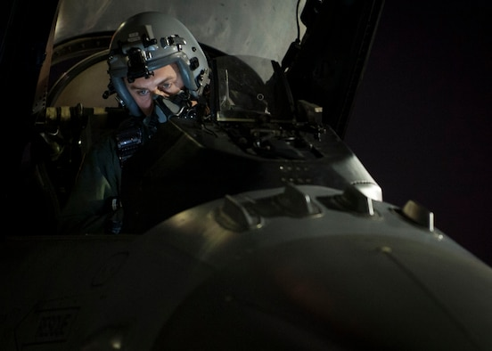 Capt. Matt Bender from the 20th Fighter Squadron, Shaw Air Force Base, S.C., conducts pre-flight checks on his F-16 before a night sortie during Red Flag 16-3 July 13. Red Flag is a realistic combat training exercise involving the air forces of the United States and its allies is conducted on the vast bombing and gunnery ranges of the Nevada Test and Training Range. (U.S. Air Force photo by Senior Airman Jake Carter)