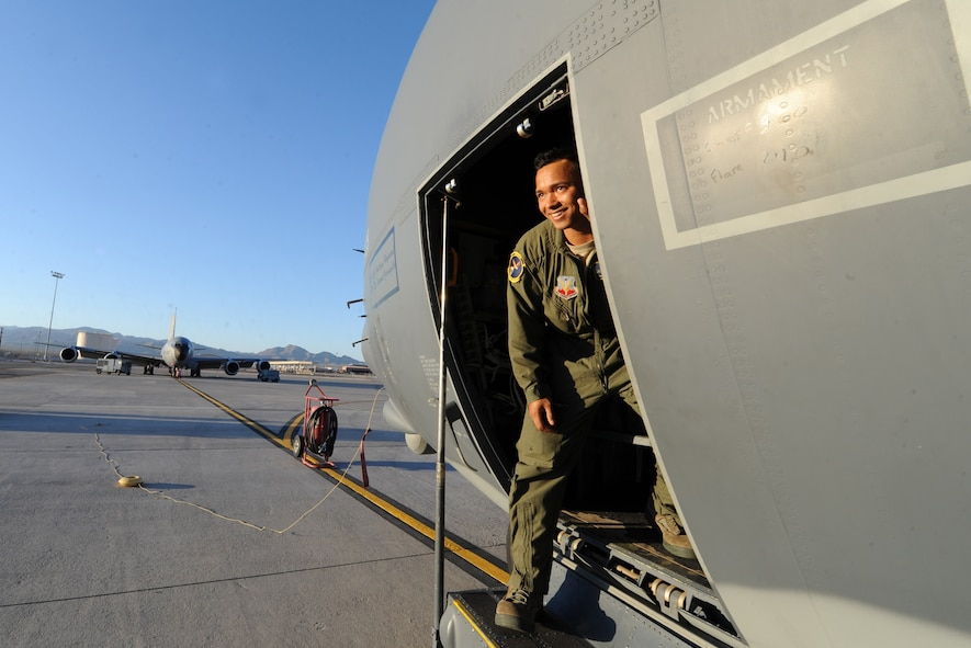 Senior Airman Frankie Harper, a loadmaster assigned to the 79th Rescue Squadron, Davis-Monthan Air Force Base, Ariz., performs pre-flight checks on an HC-130J Combat King II prior to a Red Flag 16-3 night training mission July 13, 2016 at Nellis AFB, Nev. HC-130J crews normally fly night at low to medium altitude levels in contested or sensitive environments, both over land or overwater. Crews use night vision goggles for tactical flight profiles to avoid detection to accomplish covert infiltration/exfiltration and transload operations. . (U.S. Air Force photo by Senior Airman Joshua Kleinholz/Released)
