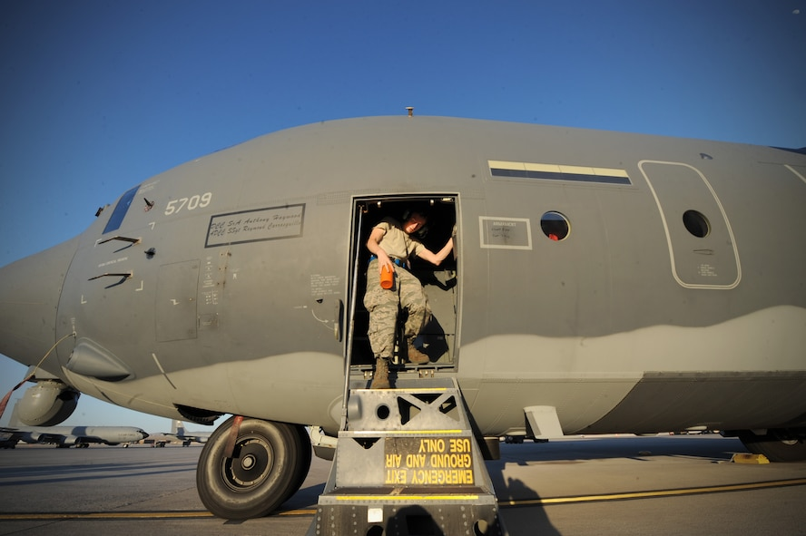 Senior Airman Timothy Thomasula, a maintainer assigned to the 923rd Aircraft Maintenance Squadron, Davis-Monthan Air Force Base, Ariz., performs pre-flight checks on an HC-130J Combat King II prior to a Red Flag 16-3 night training mission July 13, 2016 at Nellis AFB, Nev. The HC-130J is an extended-range version of the C-130J Hercules transport. Its mission is to rapidly deploy and execute combatant commander directed recovery operations to austere airfields and denied territory for expeditionary, all weather personnel recovery operations, and forward area ground refueling missions. (U.S. Air Force photo by Senior Airman Joshua Kleinholz/Released)