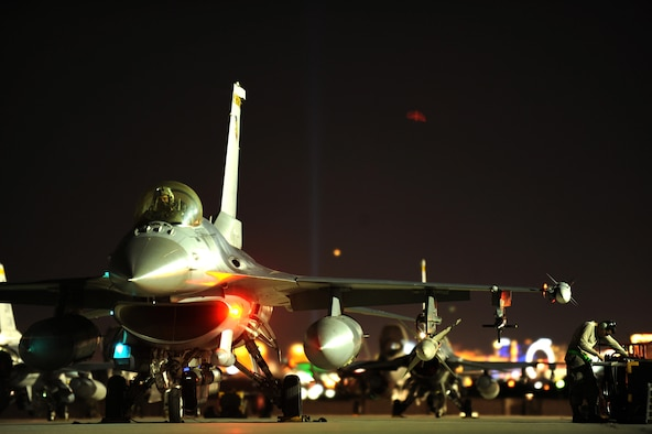 An F-16-CJ from the 79th Fighter Squadron, Shaw Air Force Base, S.C., receives final preparations prior to a Red Flag 16-3 night training mission July 13, 2016 at Nellis AFB, Nev. The night operations aspects of Red Flag is crucial for aircrews looking to gain experience in low-light situations, giving U.S. and coalition Air Forces the strategic upper hand in current and future conflicts. (U.S. Air Force photo by Senior Airman Joshua Kleinholz/Released)